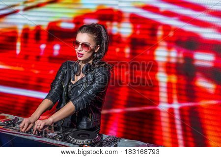 Young dj in a night club