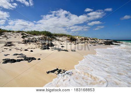 Coral La Herradura beach and turquoise water on the wild coast of Cuba