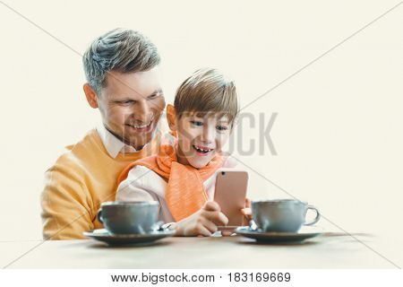 Happy father and son indoors