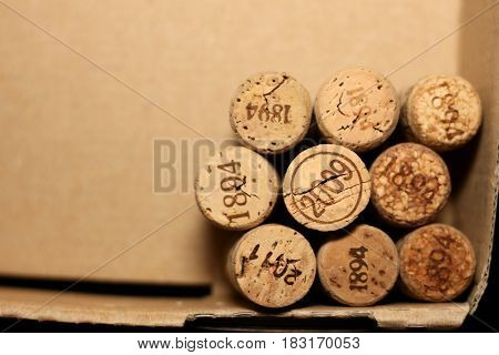 Wine corks with dates in retro style on paper background for your greeting text