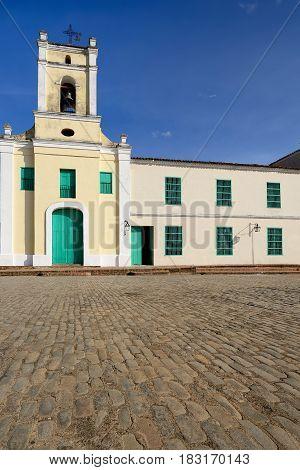 Facade of the colonial Saint John of God Church (Iglesia de San Juan de Dios) church by the San Juan de Dios square in the Camaguey town on Cuba