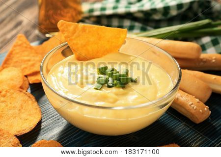 Bowl with beer cheese dip and nachos, closeup