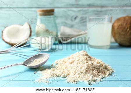 Heap of coconut flour on wooden background