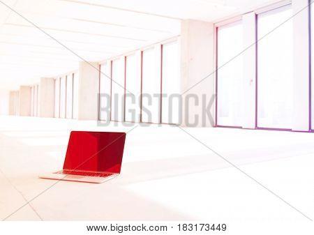 Laptop on floor of new empty office