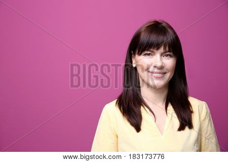 Beautiful mature woman on color background