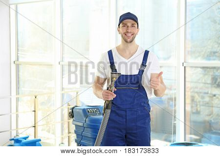 Dry cleaner's employee working in flat