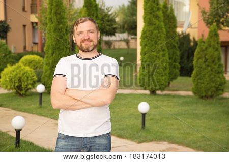 Businessman on vacation. A bearded man in a good mood.
