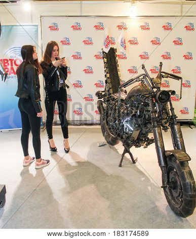 St. Petersburg Russia - 15 April, Young girls at moto concept,15 April, 2017. International Motor Show IMIS-2017 in Expoforurum. Visitors and participants of the annual moto-salon in St. Petersburg.