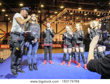 St. Petersburg Russia - 15 April, An elderly entertainer with a group of teenagers,15 April, 2017. International Motor Show IMIS-2017 in Expoforurum. Dance show group of teenagers in the style of hip-hop.