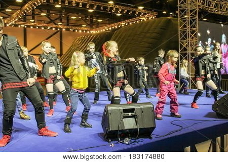 St. Petersburg Russia - 15 April, Dancing group of teenagers with children on stage,15 April, 2017. International Motor Show IMIS-2017 in Expoforurum. Dance show group of teenagers in the style of hip-hop.