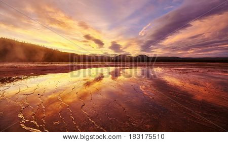 Picturesque Sunset At Grand Prismatic Spring In Yellowstone National Park, Usa.