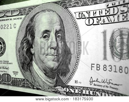 banknote 100 dollars costing on a table