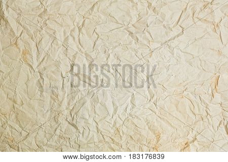 Old crumpled rough yellow paper texture horizontal background