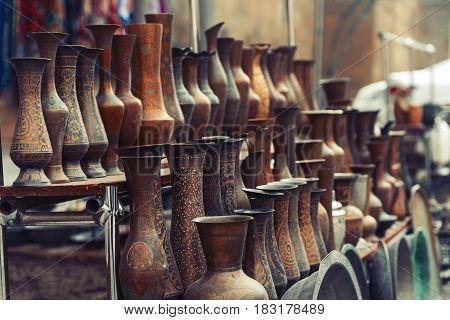 Vintage bronze vases for sale in souvenir shop