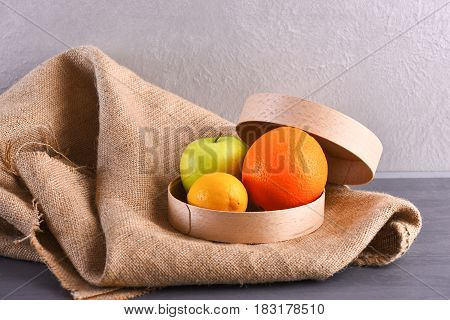 Various Fruits: Lemon, Apple, Orange On Sackcloth Napkin