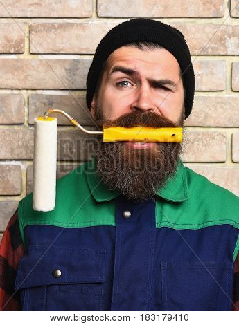 Bearded Painter Man Holding Roller Paint With Satisfied Face