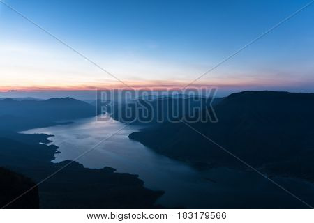 Mae Ping river view point. Sunrise above the lake and mountain.