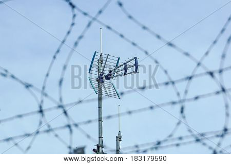 Directional antenna for reception of digital television broadcasting DVB-T and DVB-T2 against a blue sky.