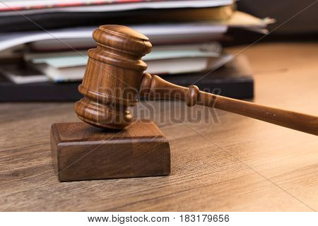 Documents, hammer on wooden table