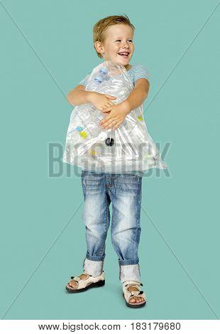 Caucasian Ethnicity Boy holding Bag with Plastic Bottles