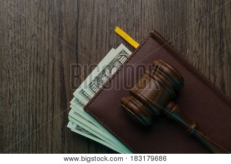 Judge on folder with dollars