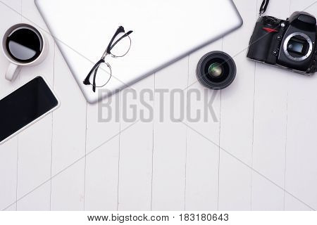 Flat Lay Photo Of Workspace Desk With Laptop, Smartphone, Coffee, Eyeglasses And Dslr Camera