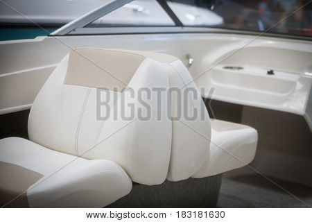Color image of some leather seats on a luxury yacht.