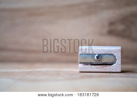 Wooden sharpener with blur vintage wooden background
