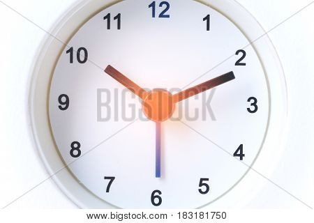 Close up image of white modern clock at 10.10 a.m