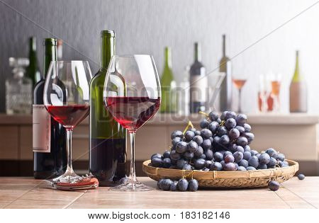 Bottle And Glasses Of Red Wine On The Kitchen Table