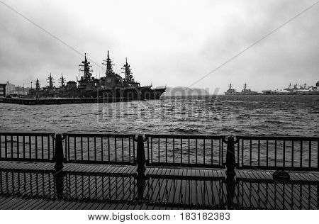 YOKOSUKA, JAPAN - APRIL 11, 2017 - Arleigh Burke-class destroyers anchored in stormy waters at the United States Fleet Activities Yokosuka Navy base