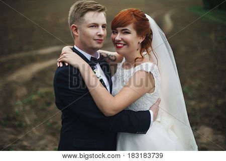 The Smilling Couple In Love Stands In The Park