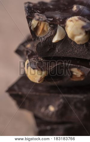 Close-up of stacked assorted dark chocolate