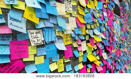 STOCKHOLM, SWEDEN - April 11, 2017: Sticky notes are pictured at a makeshift, memorial to commemorate the victims of terror attack in central Stockholm