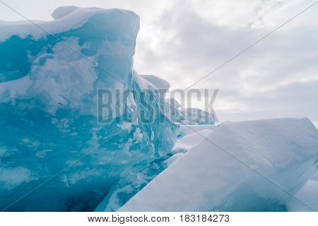 Ice blocks with snow in Frozen Lake Baikal Russia