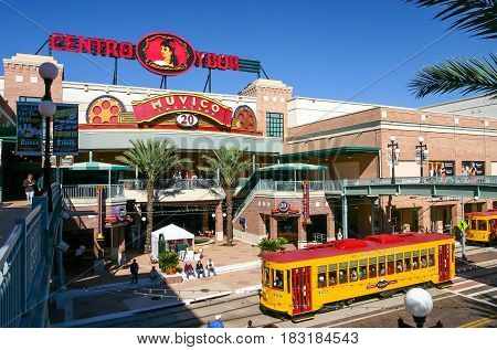 TAMPA FLORIDA US - November 29 2003: Centro Ybor entrance with yellow trams and visiting tourists Tampa FL
