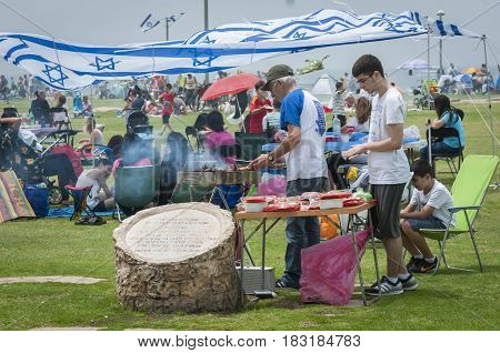 TEL AVIV, ISRAEL. May 2014. Israeli family cooking meat at the seaside on a national holiday - the Independence day of Israel.