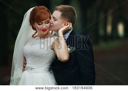 The Lovely Couple In Love Embracing In The Park