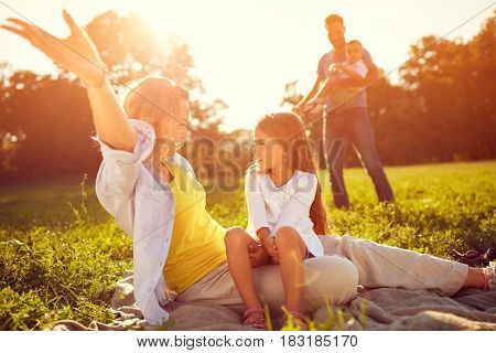 Mother with daughter enjoy on picnic in nature