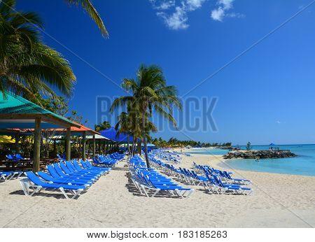 Blue sunbeds on beautiful beach. Eleuthera island Bahamas