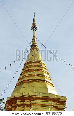 golden pagoda contain Buddha ash in Wat Phrathat Doi Kham ancient temple in Thailand