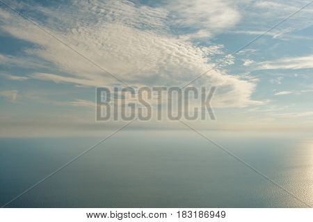 Blue sky with clouds and airplane trails over the Black sea. Nature composition in Crimea, Ukraine 2011.