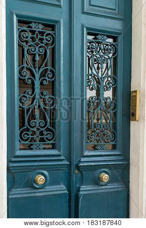 Entrance green door with metal knob