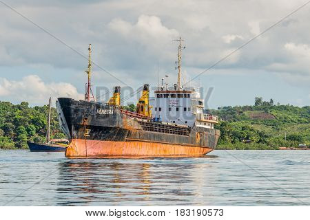Hell-Ville Madagascar - December 19 2015: General Cargo Ship Muneera (formerly known as Semlow) anchored at Hell-Ville Nosy Be Island Madagascar.