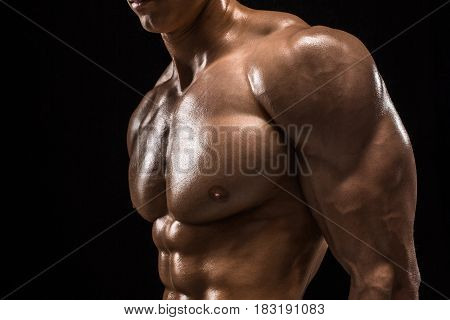 Part of a man's body on a dark background with copyspace. Studio shot on black background.