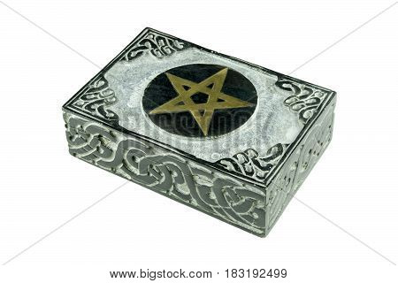 Still life with closed stone esoteric mystic box with carved sign pentagram and ornaments isolated on white background