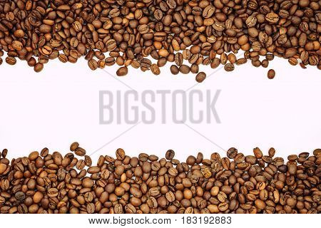 Coffee beans on a white background. There is a place for an inscription.