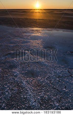 Sunset on the salt lake of Elton. Russia the Volgograd region.