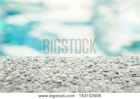 Whets stone and blue abstract background swimming pool
