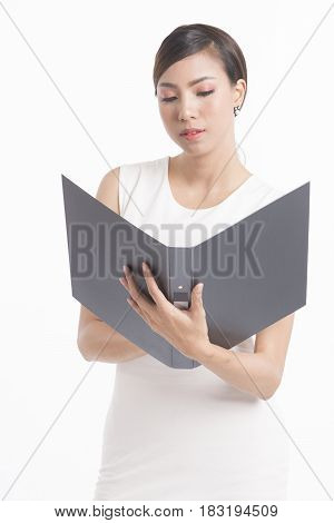 Business woman standing holding file and waring white dress on white background